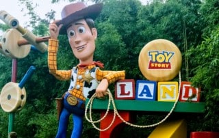Gigantic Woody doll welcoming guests to the new Toy Story land in Disney's Hollywood Studios theme park.